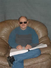 Keith Reedy, Bibles for the Blind Director, Sitting Reading Braille Bible
